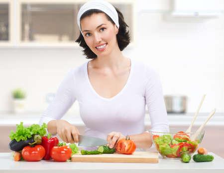 woman in kitchen making salad photo