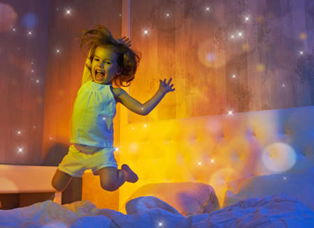 child in bed: a beautiful child enjoying life