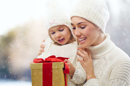 happy family with christmas gift photo