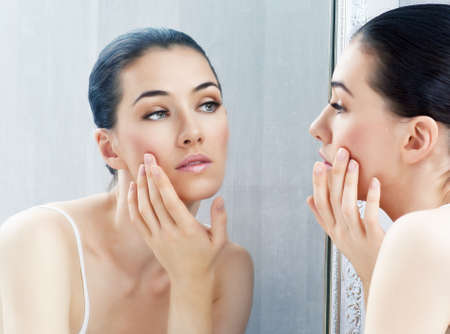 woman mirror: a beauty girl on the window background Stock Photo