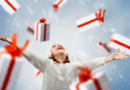 beautiful child opens a gift Stock Photo