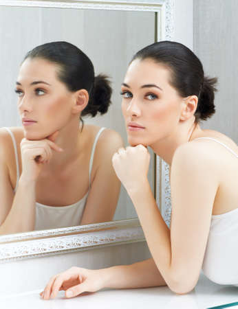 a beauty girl on the mirror background photo