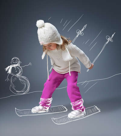 skiing: a beautiful child enjoying life