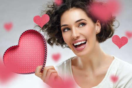 beautiful girl holding a heart photo