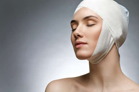 facelift: beauty woman on the grey background Stock Photo