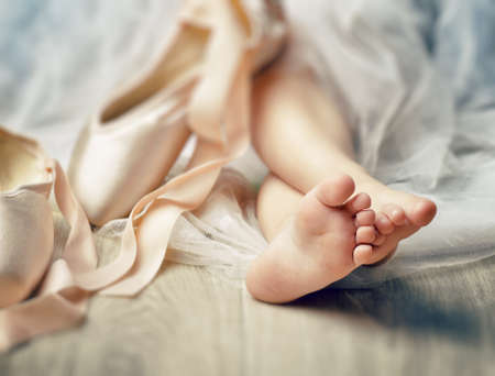 ballerina tights: Little girl trying on ballet shoes