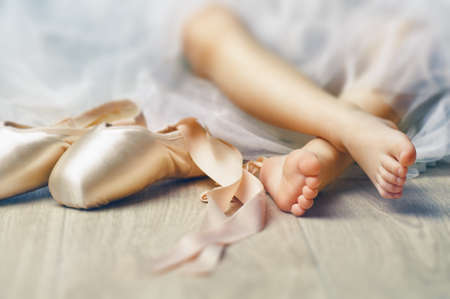 Little girl trying on ballet shoes