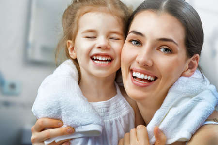 bathroom woman: daughter and mother are happy together