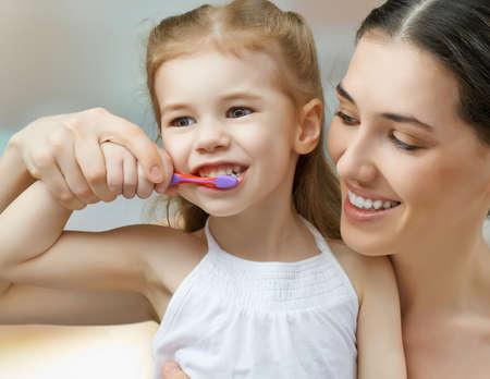 brush teeth: mother and daughter brush my teeth Stock Photo