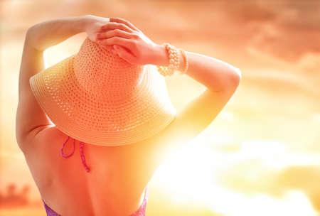 sun hat: the girl is happy summer sun Stock Photo