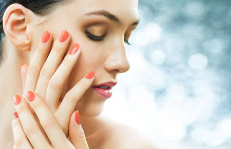 portraits: beautiful girl with red nails