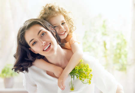 happy day: happy mother and child together