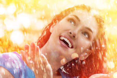 a smiling woman happy rain Stock Photo - 29464417
