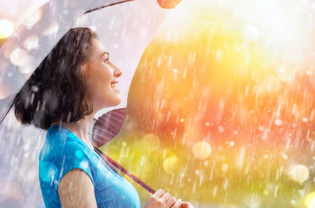 a smiling woman happy rain