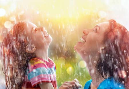 the family enjoys the rain photo