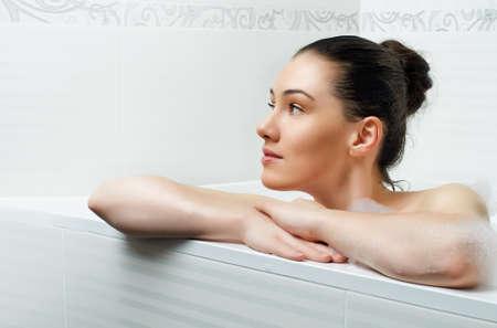 beautiful girl lying in the bathroom photo