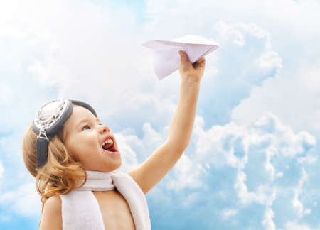 A child plays an airplane pilot photo