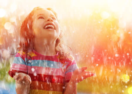 the child is happy with the rain Stock Photo