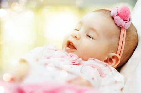 sweetly: small child was sleeping sweetly