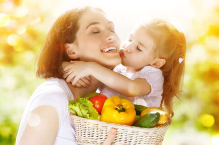 keeps: happy family keeps fresh vegetables Stock Photo