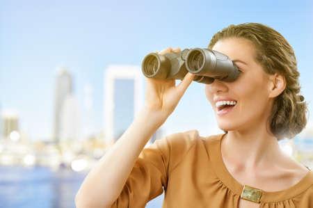 binoculars view: beauty woman looking through binoculars