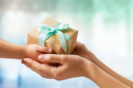 人間両手で贈り物 写真素材