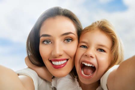 mother and daughter making a selfie photo