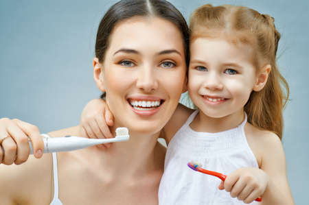 mother and daughter brush my teeth Stock Photo