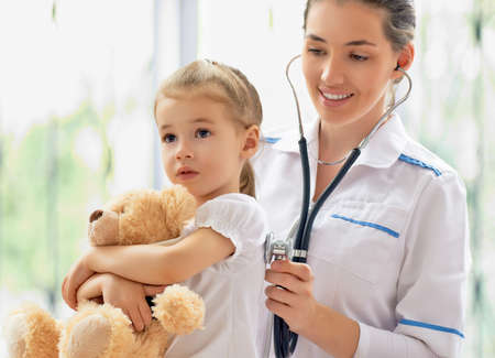 sick person: doctor examining a child in a hospital