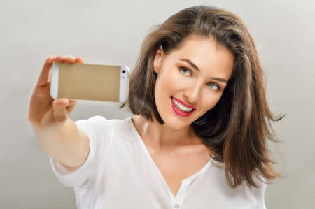 taking picture: a beauty girl taking selfie Stock Photo