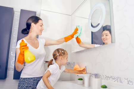 and activities: happy family do the cleaning Stock Photo