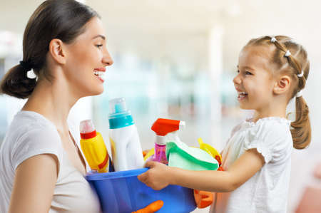 housework: happy family do the cleaning Stock Photo
