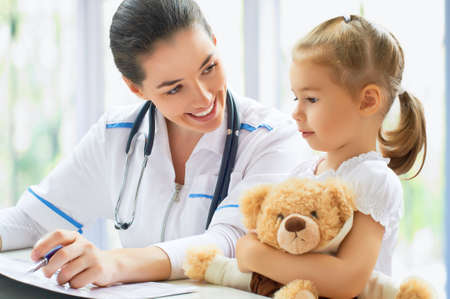 doc: doctor examining a child in a hospital