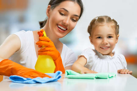 household work: happy family do the cleaning Stock Photo