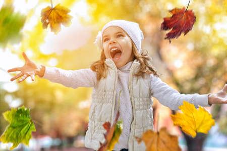 Happy child having fun in park Stock Photo