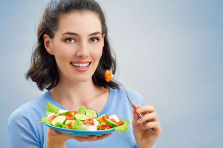 only young women: A beautiful girl eating healthy food