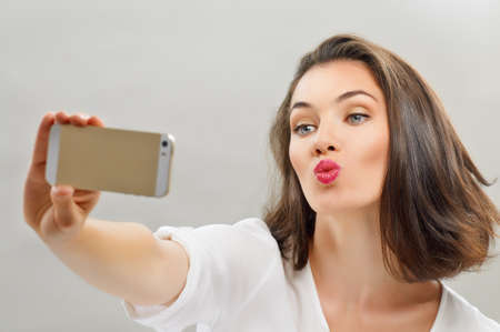 making face: a beauty girl taking selfie Stock Photo