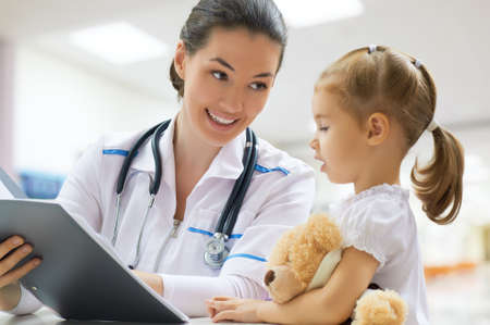medical doctors: doctor examining a child in a hospital