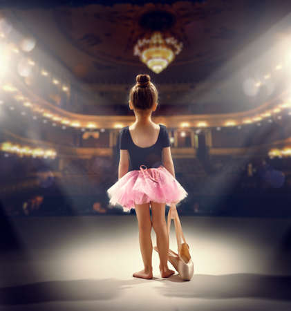 little girl plays in the ballet 스톡 콘텐츠