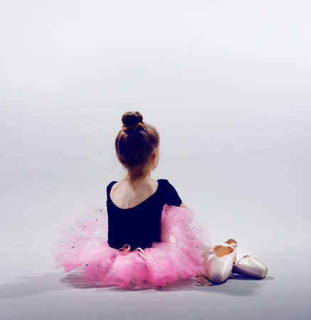 pointe: little girl plays in the ballet Stock Photo