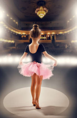 little girl plays in the ballet 写真素材