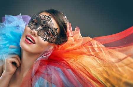 かわいい女の子は仮面舞踏会マスク 写真素材