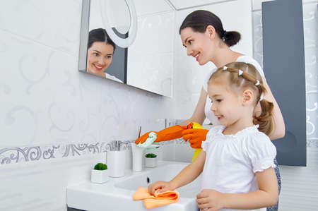 woman cleaning: happy family do the cleaning Stock Photo