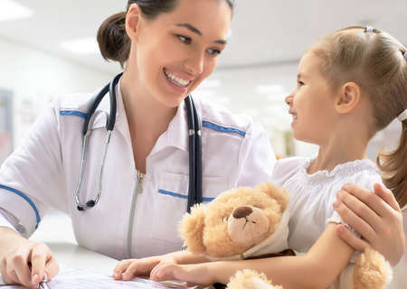 hospital patient: doctor examining a child in a hospital
