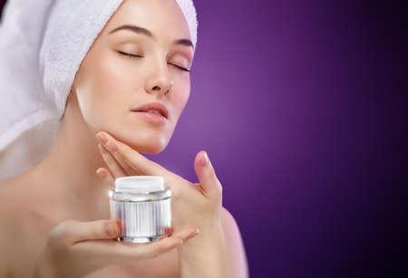 woman night: beautiful woman applying cosmetic cream