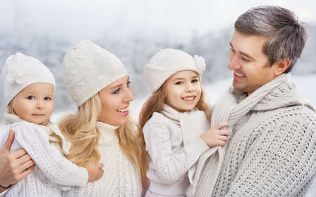 happy Family in a winter park photo
