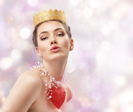 queen of hearts: beautiful woman with red heart