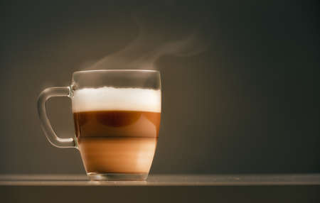 glass cup: cup of coffee on dark background Stock Photo