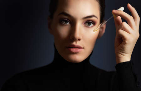beauty care: beauty woman on the dark background
