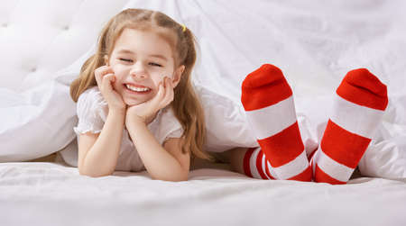 girl bedroom: sole of the feet of family